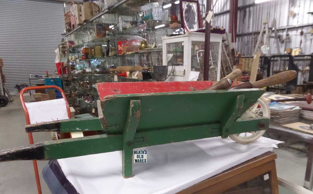 small timber wheelbarrow for sale at Heaths Old Wares, Collectables, Antiques & Industrial Antiques, 19-21 Broadway, Burringbar NSW 2483 Ph 0266771181 open 7 days
