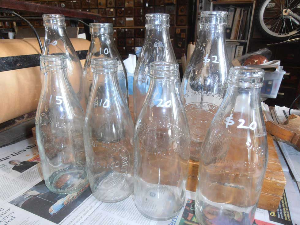 antique and vintage milk bottles, Boxes and crates, For sale at Heaths Old Wares, Antiques, Collectables and industrial antiques 12 station St bangalow NSW phone 0266872222 open 7 days