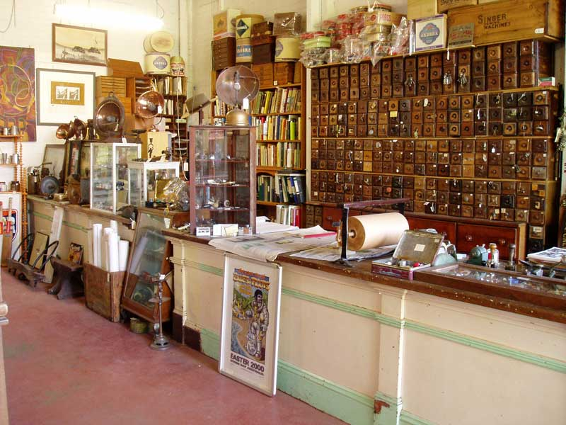 heaths old wares  antique singer draw wall and antique alstonville general store counter